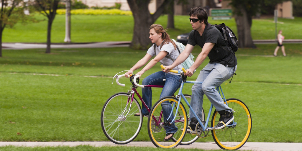 Students bicycle through the Colorado State University Oval