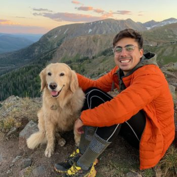 Rodríguez-Ramos with dog in the mountains